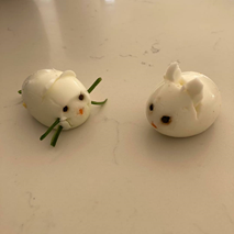 White mice decorated eggs